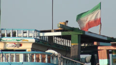 The Iranian flag on a traditional wooden fishing boat Stock Footage