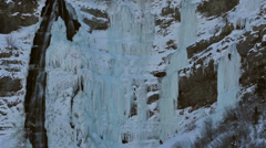 Stock Video Footage of Ice climbers on sheer frozen mountain waterfall HD 0207