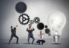Teamwork powering an idea Stock Photos