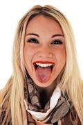 Girl showing pierced tongue. Stock Photos