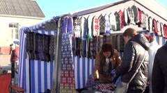 In wind sway woolen gloves hanging on the ropes at market stall Stock Footage