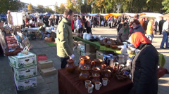 Craftsman sell produce ceramic mugs jars jugs market stall Stock Footage