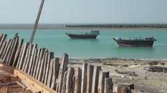 Small Lenj fishing boats, from a vessel under construction, Iran, Persian Gulf Stock Footage