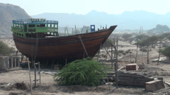 Traditional wooden vessel, desert landscape, construction, Iran Stock Footage