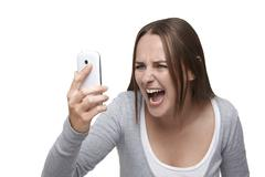 Shouting to mobile phone Stock Photos