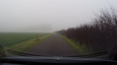 Vehicle shot in dense fog, Dutch river foreland with row of poplar trees Stock Footage