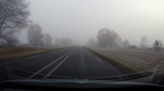 Vehicle shot in mist, moorland, The Netherlands Stock Footage