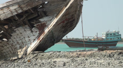 Shipwreck and 'Lenj' vessel in Persian Gulf, Iran Stock Footage