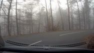 Stock Video Footage of Vehicle shot in mist, descending in hairpin turn in the Veluwe moraine hills