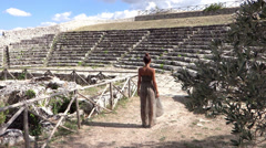 beautiful young girl in an ancient greek theater - stock footage