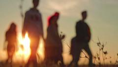 young people in warm sunset - stock footage