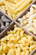 Pasta assortment of different colors background Stock Photos