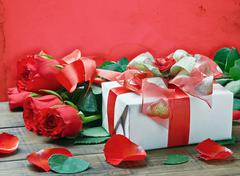 Red roses and gift box for birthday, valentine, anniversary Stock Photos