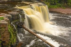 Colorful cascade in the wilds Stock Photos