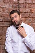 desperate man with a chain around his neck - stock photo