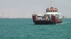 Ferry boat sails over Persian Gulf from mainland Iran Stock Footage