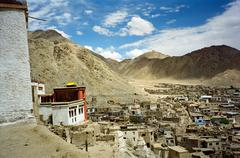 Leh, the capital of ladakh seen from the hilll with leh gompa in foreground a Stock Photos