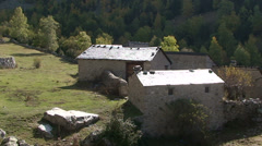 Slate roofs stone houses backlit Stock Footage