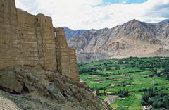 leh, the capital of ladakh seen from the hilll with ruins of leh palace in fo - stock photo