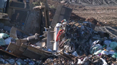 BULLDOZER ENVIRONMENTAL LANDFILL GARBAGE DUMP AND RECYCLING  HD  1080 1920X1080 - stock footage