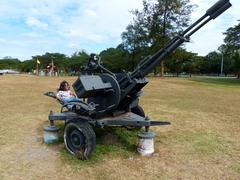 little girl in anti aircraft gun - stock photo