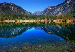 gold lake reflection mt chikamin peak snoqualme pass washington - stock photo