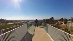 Man Enjoying View From Civic Center Park Bridge- Newport Beach CA Stock Footage