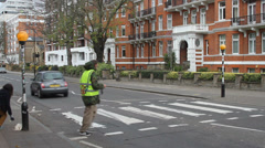 Abbey Road Crosswalk posing Stock Footage