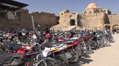 Motorcycle parking lot, outside the Isfahan bazaar in Iran Stock Footage