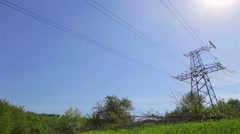 High voltage tower in green field Stock Footage
