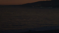 Beach sunset with mountians and ocean Stock Footage