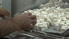 Sorting pieces of nougat by hand in factory in Iran Stock Footage