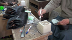 Shoe repair shop in Iran Stock Footage