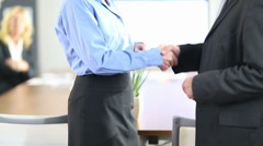 handshake with business people in office - stock footage