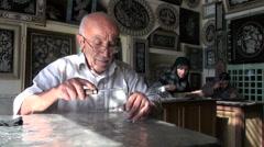 Artisan decoration artefacts souvenirs tourism workshop bazaar Iran Stock Footage