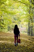 girl walking through forest - stock photo