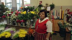 Woman flower seller in traditional costume, funchal market, madeira, portugal Stock Footage