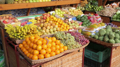 Fruit and vegetable stall at funchal workers market, madeira, portugal Stock Footage