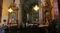 Tourists visit interior of church of our lady of monte, funchal, madeira Stock Footage