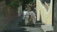 tourists take toboggan ride in funchal, madeira, portugal - stock footage