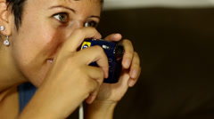 Woman laughing while holding digital camera Stock Footage