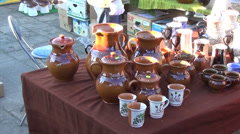 Brown varnished clay handmade pots city market Stock Footage