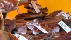 Piles on stall put smoked meat products with price cards Stock Footage