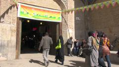 Isfahan bazaar, entrance, senior men, Iran Stock Footage