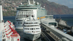 Cruise ship pulls away from harbour wall, funchal, madeira, portugal Stock Footage