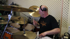 Man playing drums on a studio Stock Footage