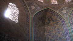 Beams of sunlight shine on mosaic of Lotfollah mosque in Isfahan Iran Stock Footage