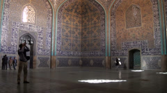 Tourist takes picture inside Lotfollah mosque in Isfahan Stock Footage