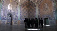 Iranian tourists visit Lotfollah mosque with a guide Stock Footage