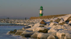 Winter in Germany - Lighthouse in Warnemünde, Baltic Sea Stock Footage
